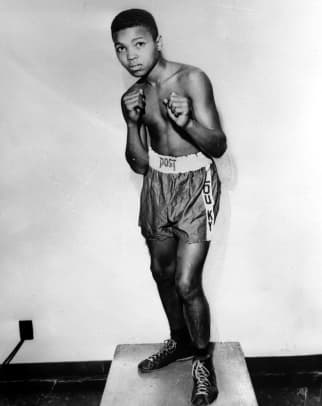 1_Cassius Clay (later Muhammad Ali) pictured as a young boy of age 12 at a gym in Louisville, Kentucky, USA at the beginning of his career, 1954 (Photo by Popperfoto:Getty Images)