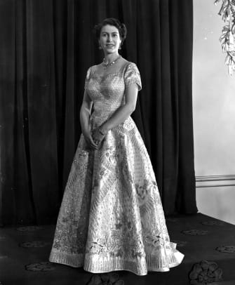 1_Queen Elizabeth II wearing a gown designed by Norman Hartnell for her Coronation ceremony. (Photo by Central Press:Getty Images)
