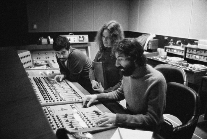 Recording engineer Hank Cicalo, singer-songwriter Carole King and record producer Lou Adler gather around the mixing desk in the control room of A&M Records Recording Studio in January 1971 during the recording of King's album 'Tapestry'