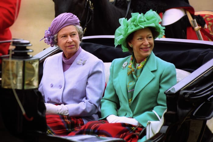 Queen Elizabeth II (L) and Princess Margaret arriving by carriage at Horse Guards Parade, London in May 1993