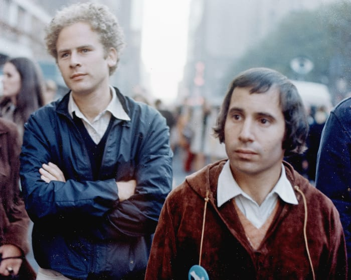 Art Garfunkel (L) and Paul Simon during the filming of a television special called