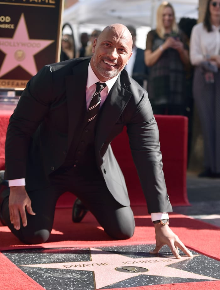 Dwayne Johnson attends a ceremony honoring him with the 2,624th star on the Hollywood Walk of Fame on December 13, 2017, in Hollywood, California