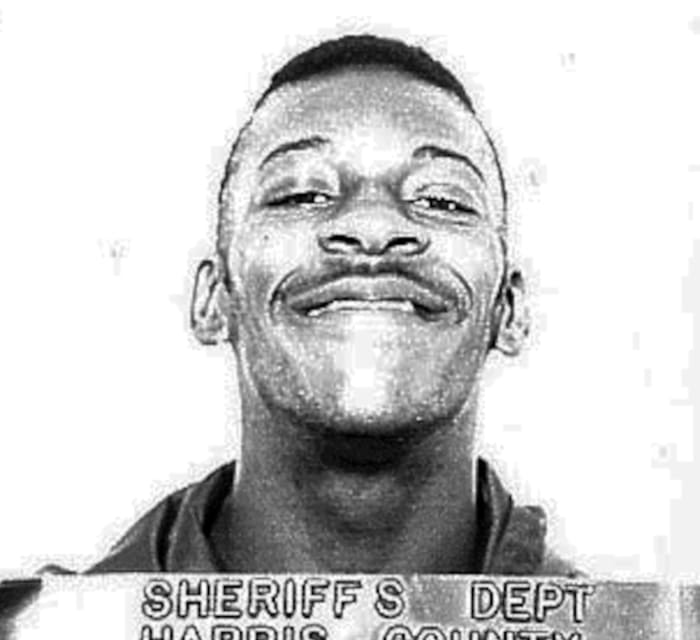 Booker T, aka Robert Huffman, in a mug shot following his arrest for armed robbery at Wendy's restaurants in Houston, Texas, 1987