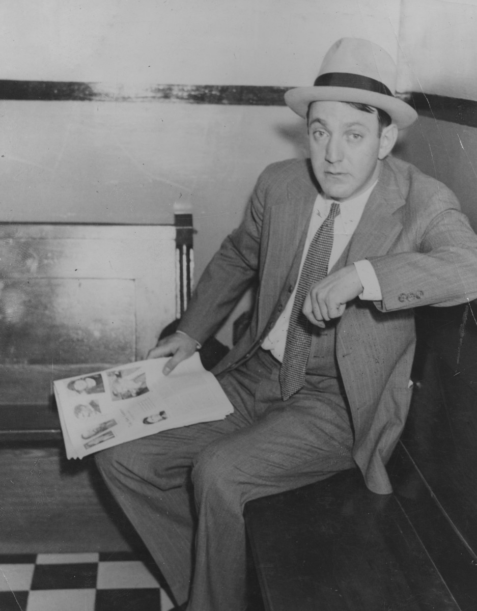 Infamous Mobsters: Jewish-American gangster Dutch Schultz awaits the verdict in his trial for income tax evasion in 1935. While the bootlegger avoided a conviction, he was assassinated later that year on orders from the Mafia's ruling body, the Commission.
