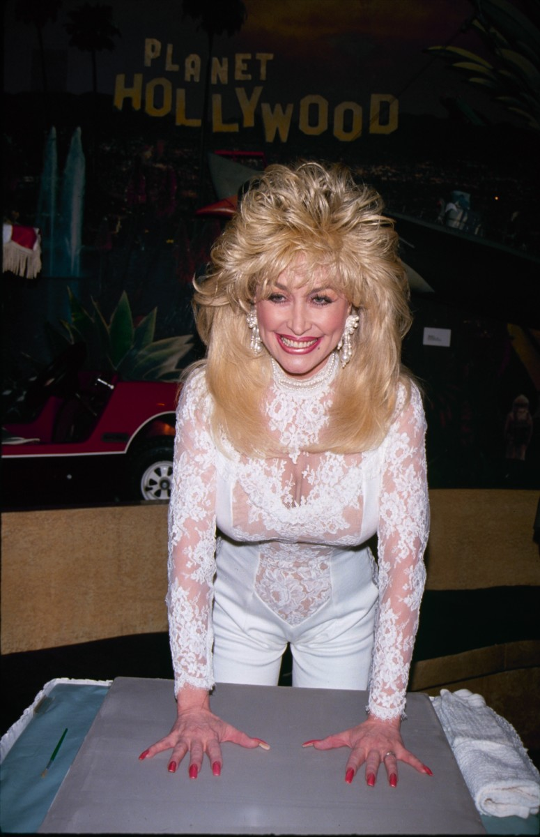 Dolly Parton's hair knows what it feels to be the victim of a hurricane.