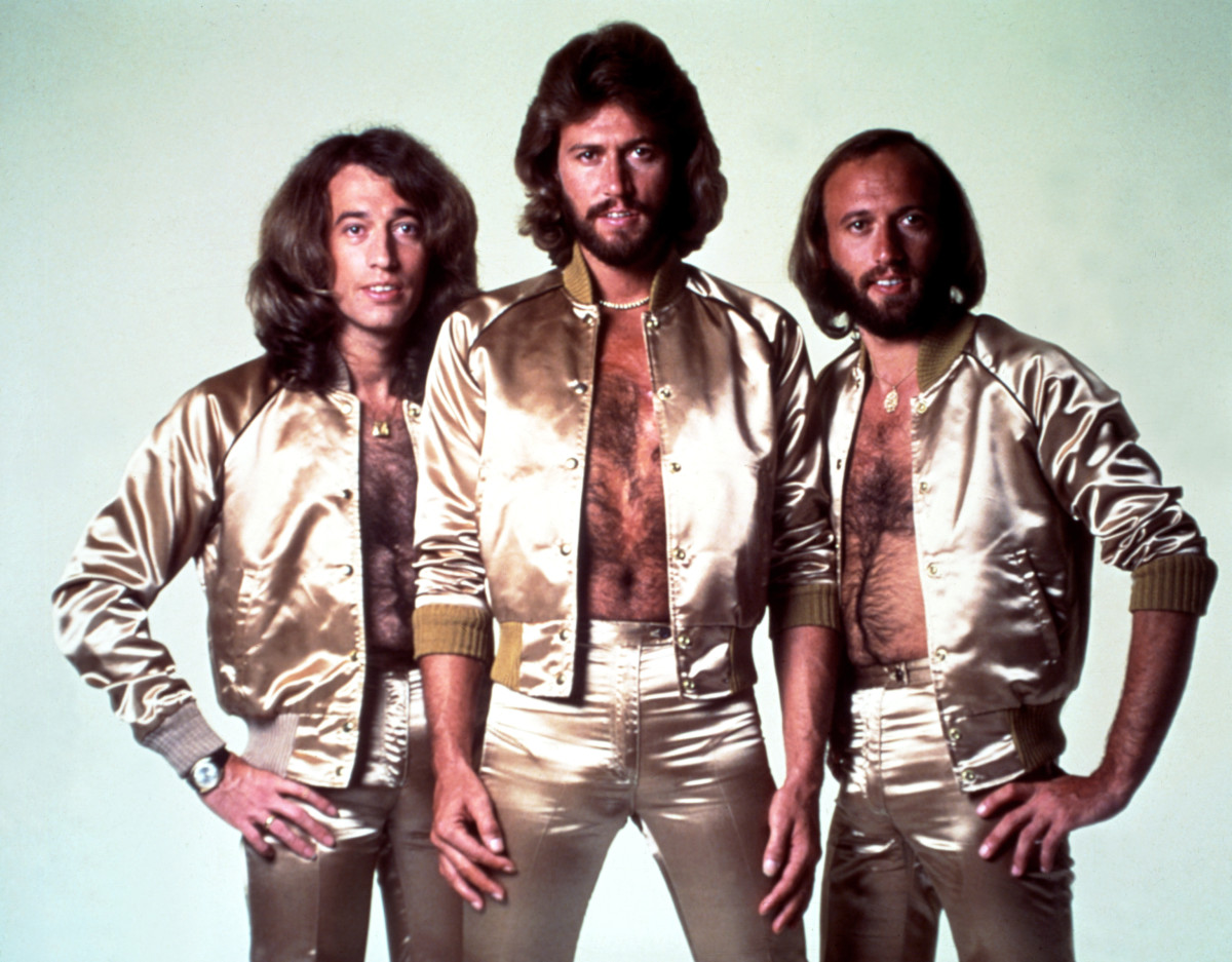 Bee Gees: The 1970s was the golden age for the Bee Gees. Here, Robin, Barry and Maurice Gibb show off their bright duds (and furry manly man chests) as a symbol of their disco-pop reign.