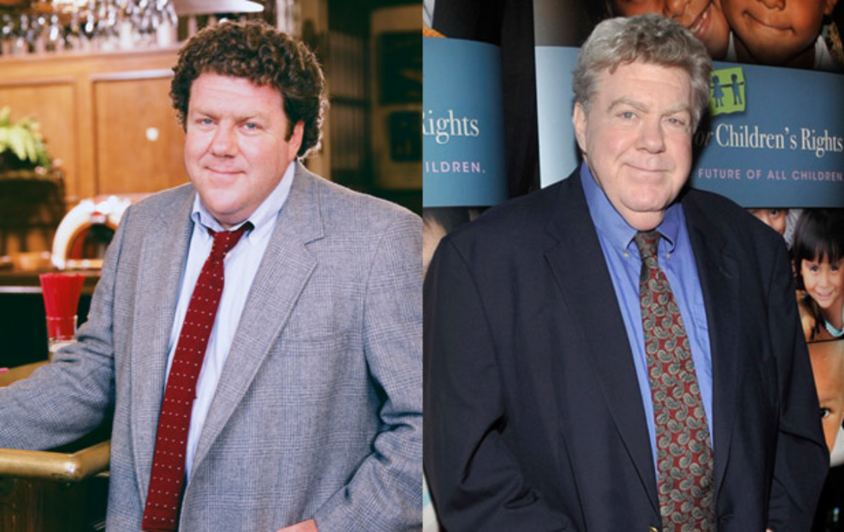 Where Are They Now: Cast of Cheers: An alumni of The Second City improv troupe, George Wendt appeared in TV shows including Taxi and M*A*S*H before playing bar fly Norm Peterson on Cheers. Post-Cheers he had his own show The George Wendt Show, which had a short run, and appeared in several TV shows as well as onstage, starring as Edna Turnblad in productions of Hairspray and as Santa in Broadway's Elf the Musical. (Left) Photo by NBC/NBCU Photo Bank via Getty Images. (Right) Photo by John M. Heller/Getty Images.