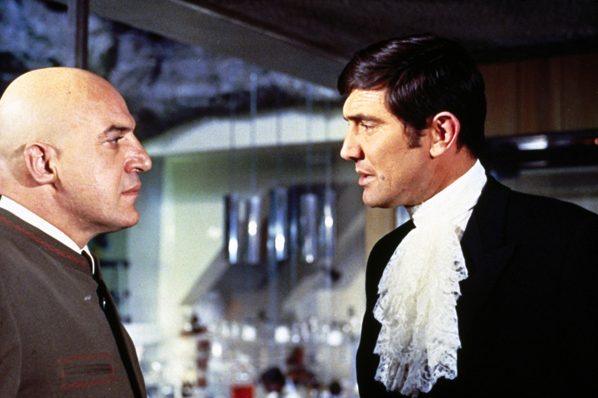 James Bond Actors: In the 1969 film, On Her Majesty's Secret Service, the sixth 007 film, model and actor George Lazenby stepped in to play James Bond opposite the villain Biofeld (Telly Savalas) and his 'angels of death.' This was Lazenby's first and only Bond film. (Photo courtesy of PhotoFest)