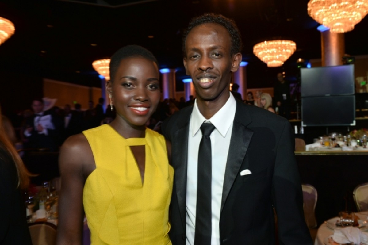 Lupita Nyong'o and Barkhad Abdi both made separate film debuts this past year and are up for Oscars in the Best Supporting Actress/Actor category. (Getty)