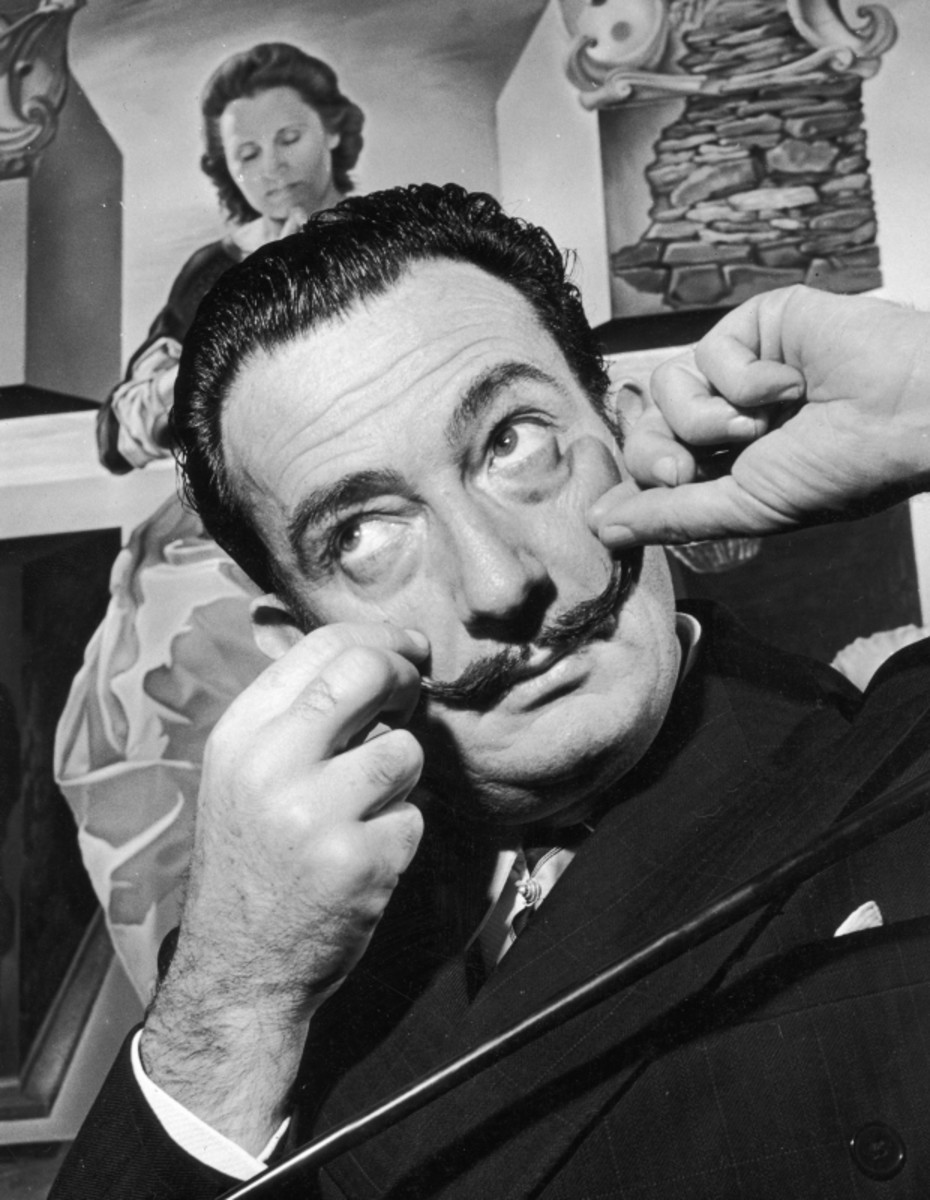 Dali poses with one of his works, 'The Madonna of Port Lligat,' in 1951. (Getty)