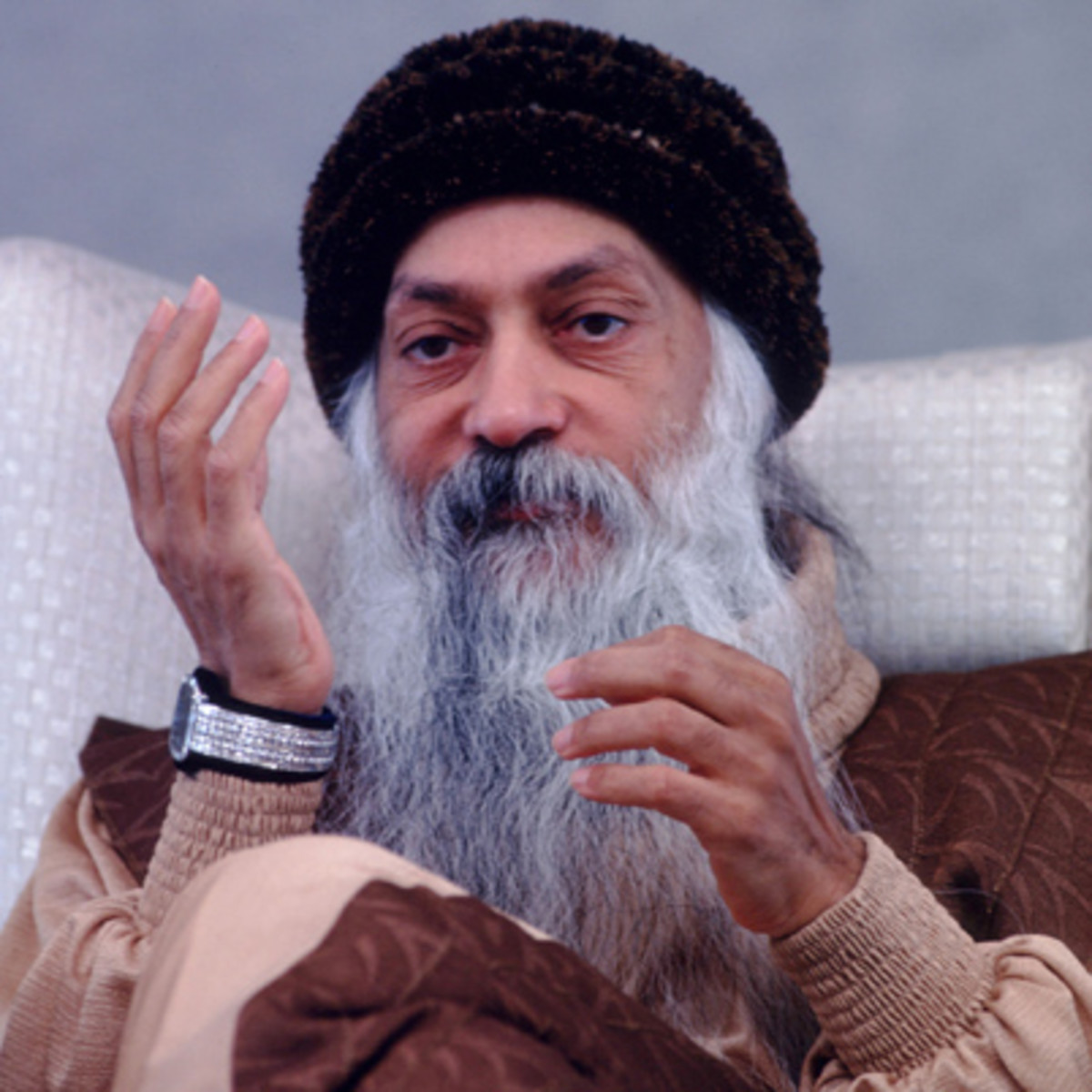 33155 05: Bhagwan Shree Rajneesh leads his disciples in a devotional ritual at the Rajneeshpuram Ranch October 14, 1984 in Eastern Oregon. Charismatic Indian Guru Rajneesh and his followers settled on the 65,000 acre ranch in the hopes of seeking and spreading the message of religious enlightenment, but encountered resistance from local communities and anti-cult groups. (Photo by Matthew Naythons/Liaison)