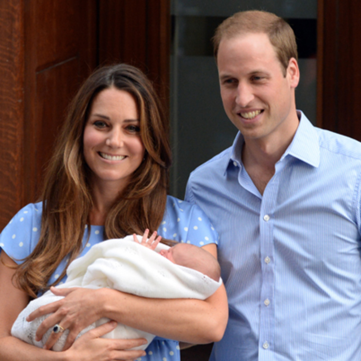 LONDON, UNITED KINGDOM - JULY 23:  Prince William, Duke of Cambridge and Catherine, Duchess of Cambridge with their newborn son pose for the media before departing the Lindo Wing of St Mary's Hospital on July 23, 2013 in London, England. Catherine, Duchess of Cambridge yesterday gave birth to a boy at 16.24 BST and weighing 8lb 6oz, with Prince William, Duke of Cambridge at her side. The baby, as yet unnamed, is third in line to the throne and becomes the Prince of Cambridge.  (Photo by Anwar Hussein/WireImage)
