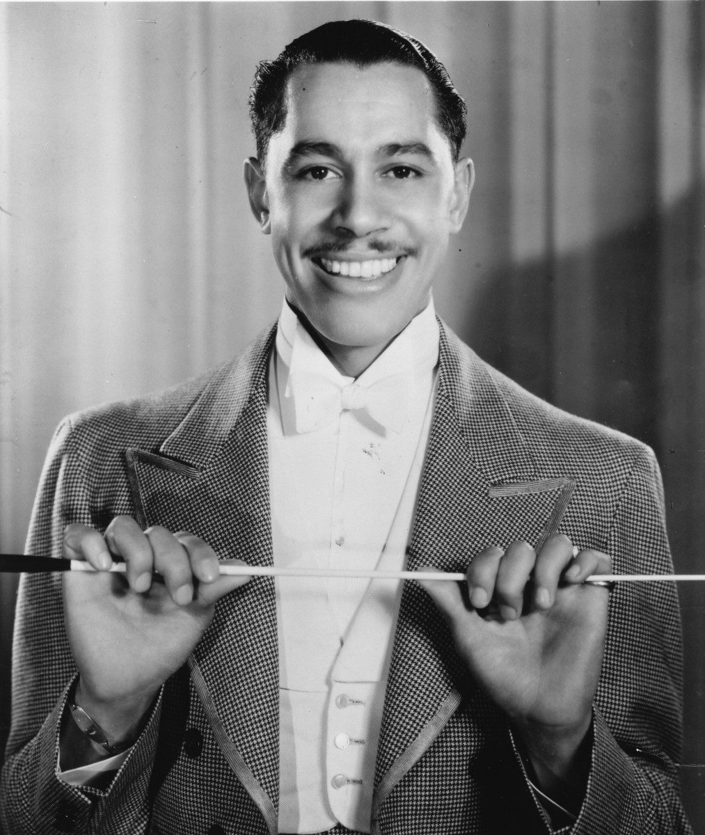 Harlem Renaissance Figures: Cab Calloway regularly performed at Harlem's segregated Cotton Club during the 1930s, slowly changing the way that African-Americans were seen by the public. (Photo by Gilles Petard/Redferns)
