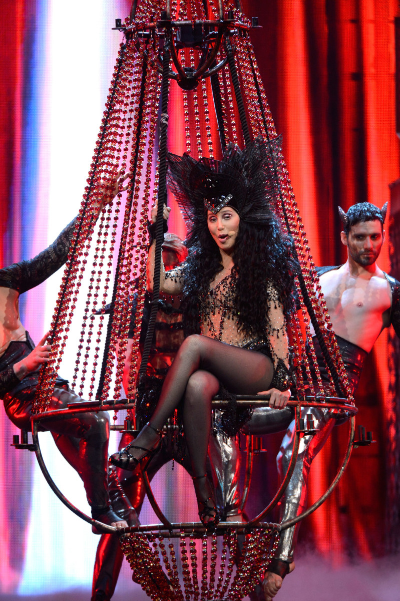 Cher performs during her 'Dress to Kill' tour, 2014. (Photo: Kevin Mazur/WireImage)