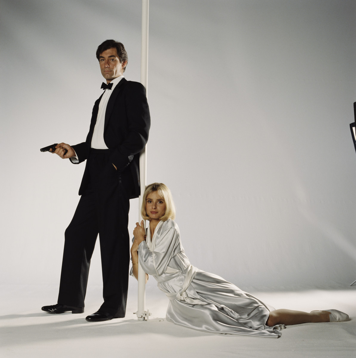 James Bond Actors: Timothy Dalton took over as 007 in the 1986 film, The Living Daylights, pictured here with Bond girl Maryam d'Abo.  (. (Photo by Keith Hamshere/Getty Images)