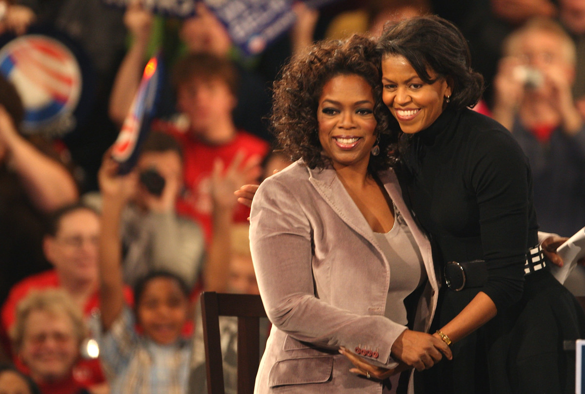 Oprah Winfrey and Michelle hug it out as they campaign for Obama in Des Moines, Iowa, in 2007.
