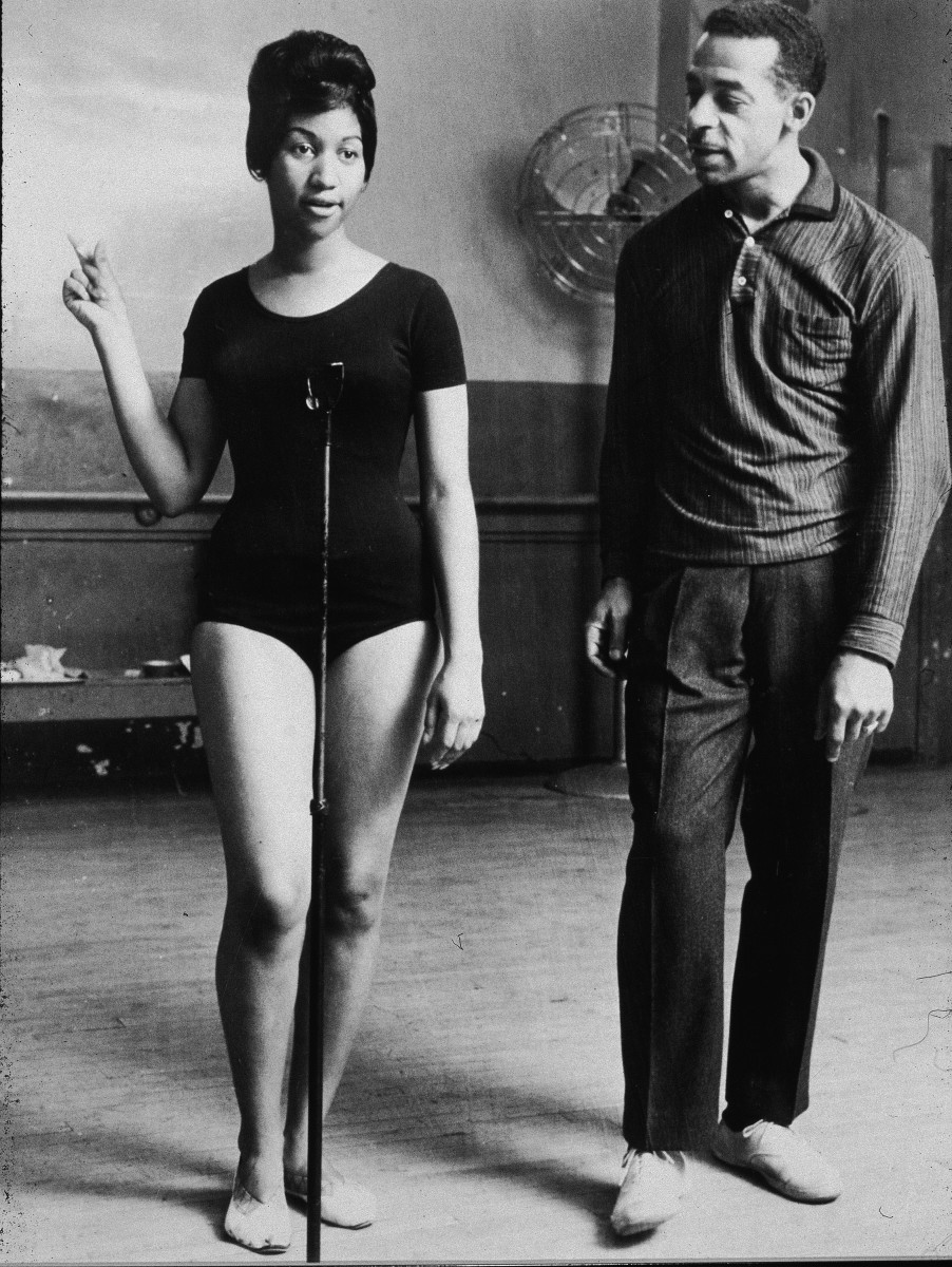Aretha Franklin: Just starting out in her career, Aretha Franklin stands in a leotard while choreographer Cholly Atkins  instructs  her during a rehearsal in 1961. (Photo by Frank Driggs  Collection/Getty Images)