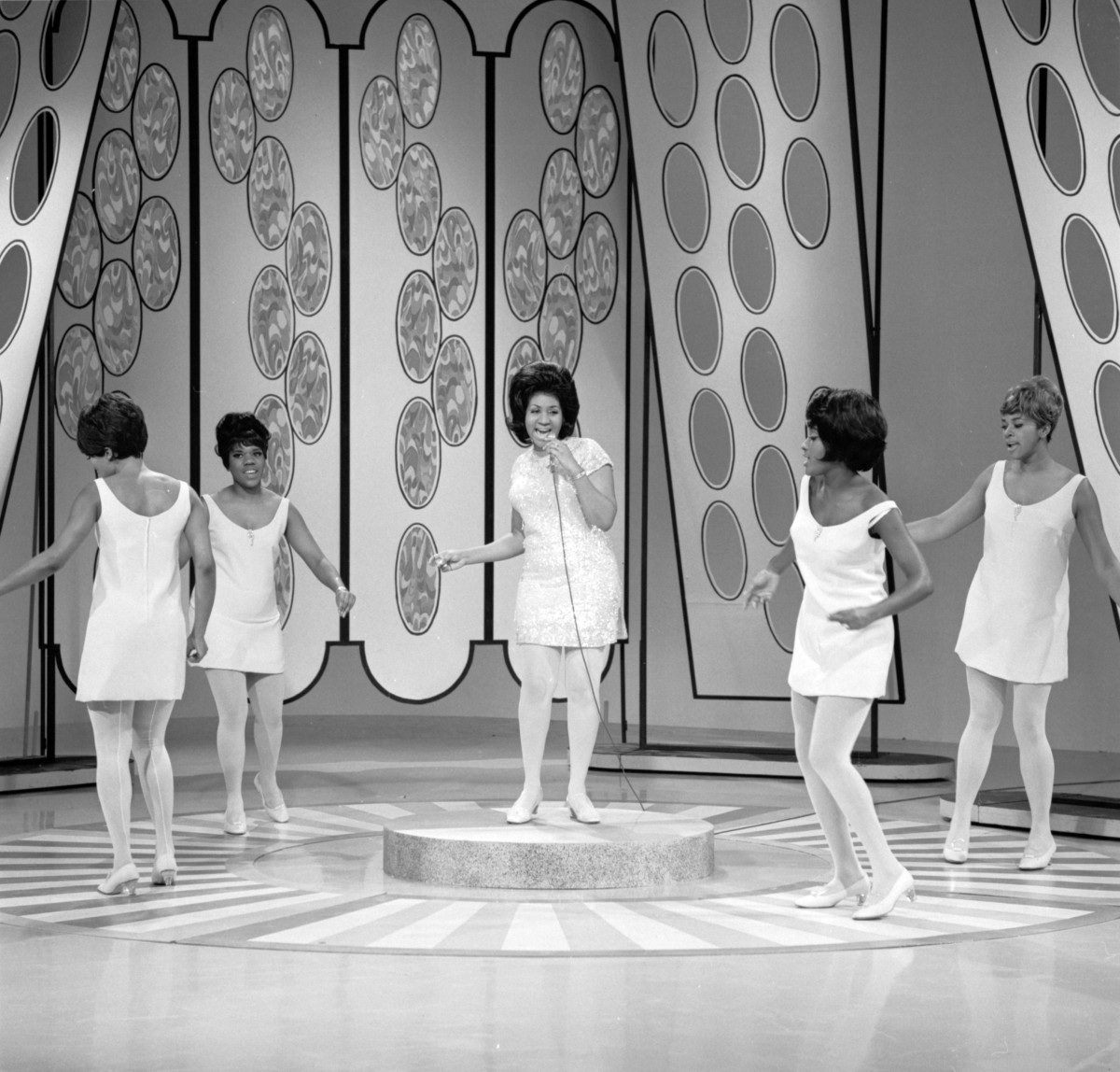 Aretha Franklin: Surrounded by backup dancers, Aretha Franklin grows as a star after appearing on The Jonathan Winters Show on January 5, 1968. (Photo by CBS via Getty  Images)