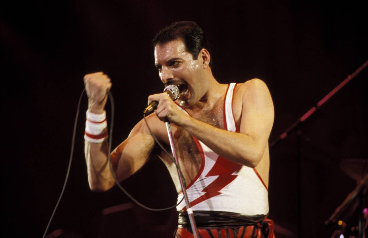 Freddie Mercury: In A Flash: Freddie Mercury performs his last live concert with Queen in 1986, in front of thousands of fans, at Wembley Stadium in London. Mercury wore a Flash Gordon tank during the performance—a symbol, then, of the band's 1980 recording for the film Flash Gordon; and a reminder, today, of Mercury's last show and untimely death four years later. (Photo by Bob King/Redferns.)