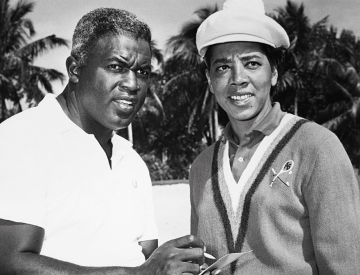 Jackie Robinson: Robinson, who recently was named to Baseball's Hall of Fame, and Althea Gibson, former amateur tennis champion, are shown checking the tally. Miss Gibson was leading the tournament's women's division while Robinson was a top contender among the men.
