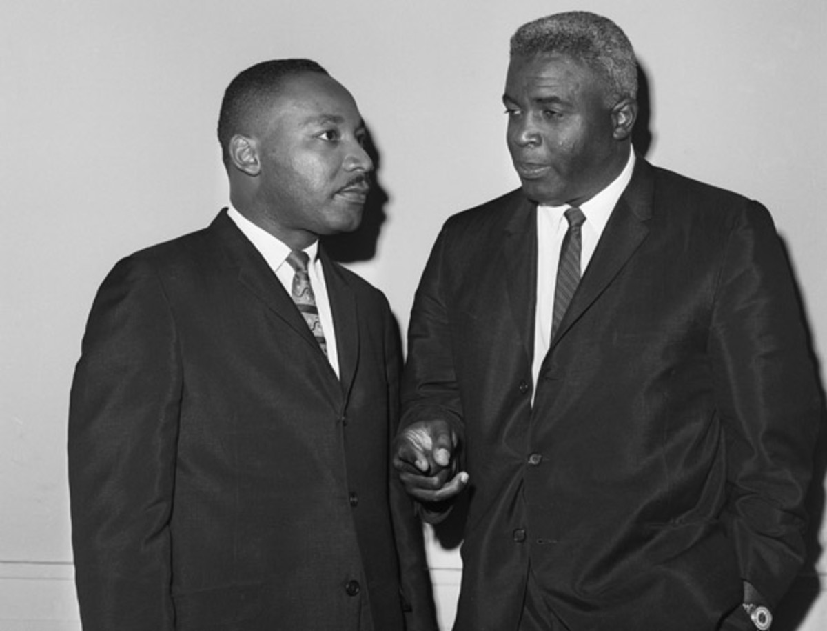 Jackie Robinson: The Rev. Dr. Martin Luther King Jr. and baseball Hall-of-Famer Jackie Robinson chat together before a press conference in New York.