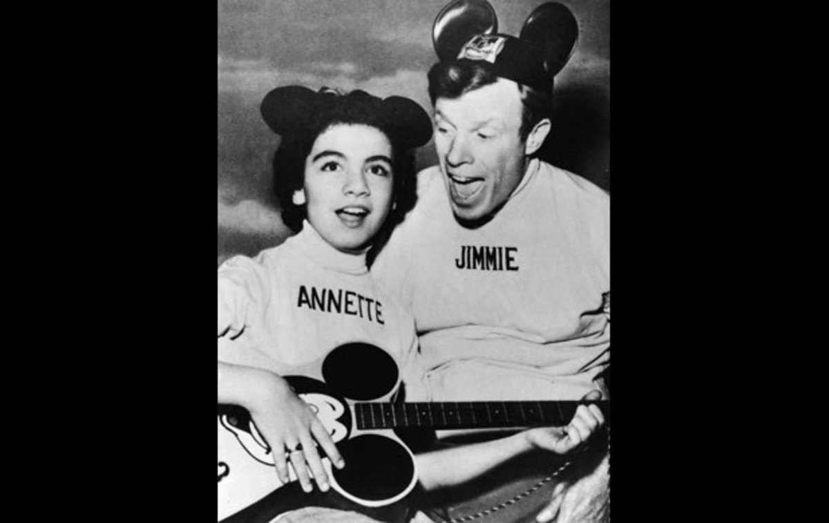 Annette Funicello: Annette Funicello plays along with Mickey Mouse Club emcee Jimmie Dodd, who also wrote the show's popular theme song. (Photo by Hulton Archive/Getty Images