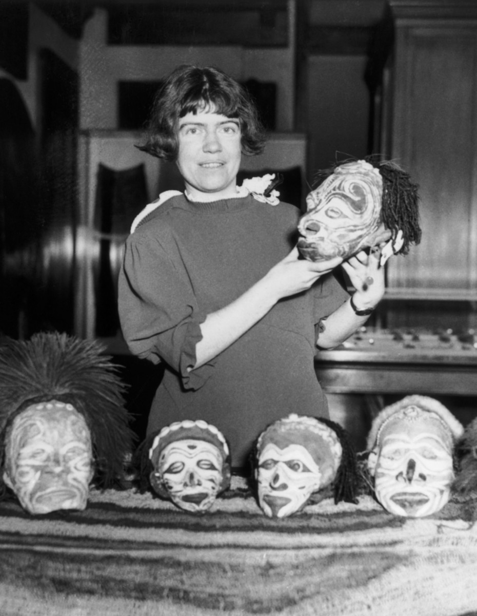 Margaret Mead with several tzantzas, or shrunken heads, that she received from one of her voyages into New Guinea, 1934. (Getty)