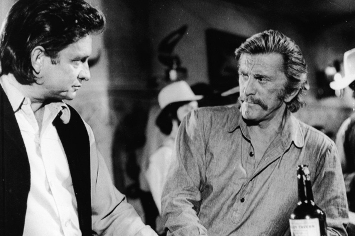 Cash and Kirk Douglas in 'A Gunfight' still, 1970. (Photo: Paramount Pictures/Courtesy of Getty Images)