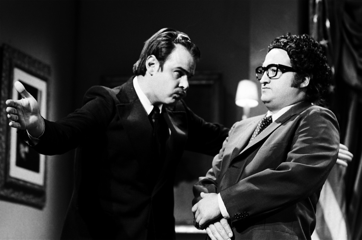 SNL Presidents: Nixed? Dan Aykroyd pulls out all the cards as Richard Nixon, while a stiff-looking John Belushi is Henry Kissinger during the 'Final Days' skit in 1976. (Photo by NBC/NBCU Photo Bank via Getty Images).