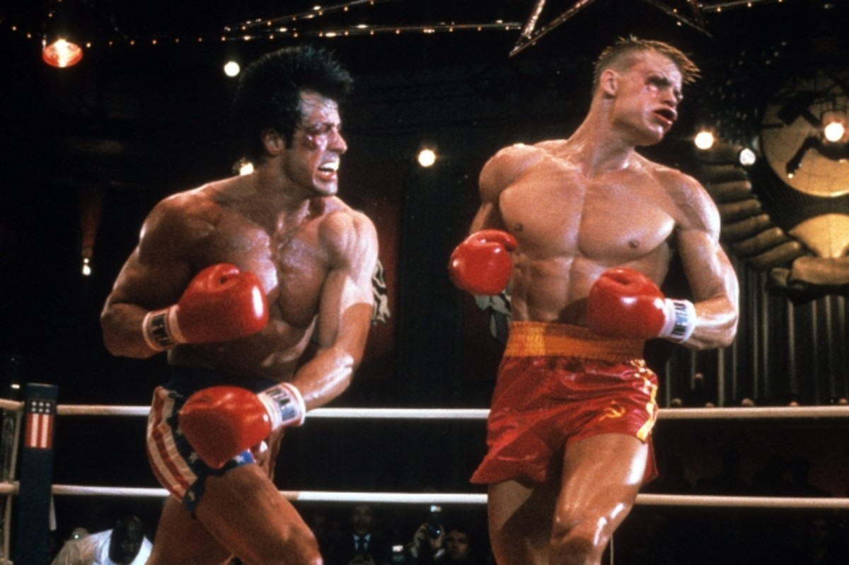 Stallone and Lundgren as Rocky and Drago, duking it out for their countries. (Getty)
