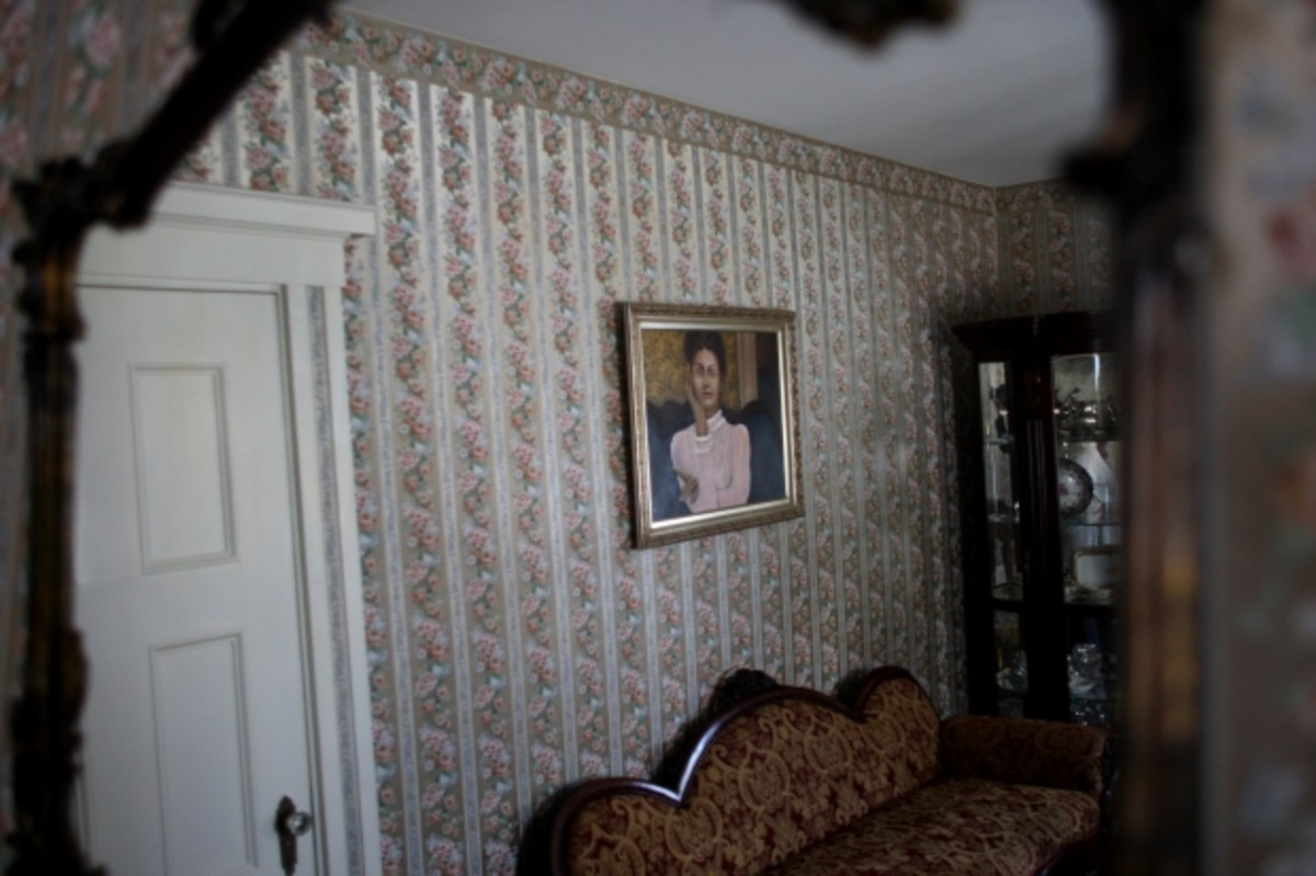 A portrait of Lizzie Borden hangs in one of the rooms at the Bed & Breakfast, 2008. (Photo by Jonathan Wiggs/The Boston Globe via Getty Images)