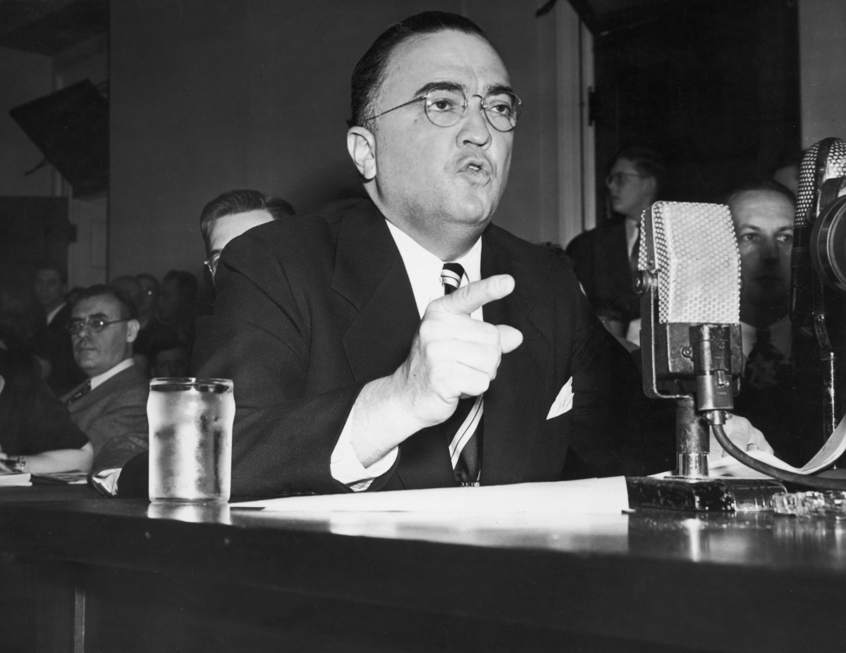 J. Edgar Hoover points his finger while testifying before the House on Un-American Activities Committee, Washington, DC. (Photo: Hulton Archive / Getty Images)