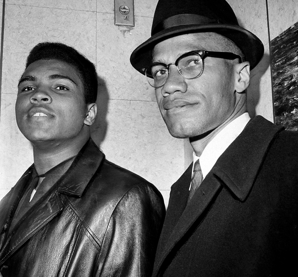 Muhammad Ali stands with fellow Muslim and civil rights activist Malcolm X in New York City on March 2, 1964.