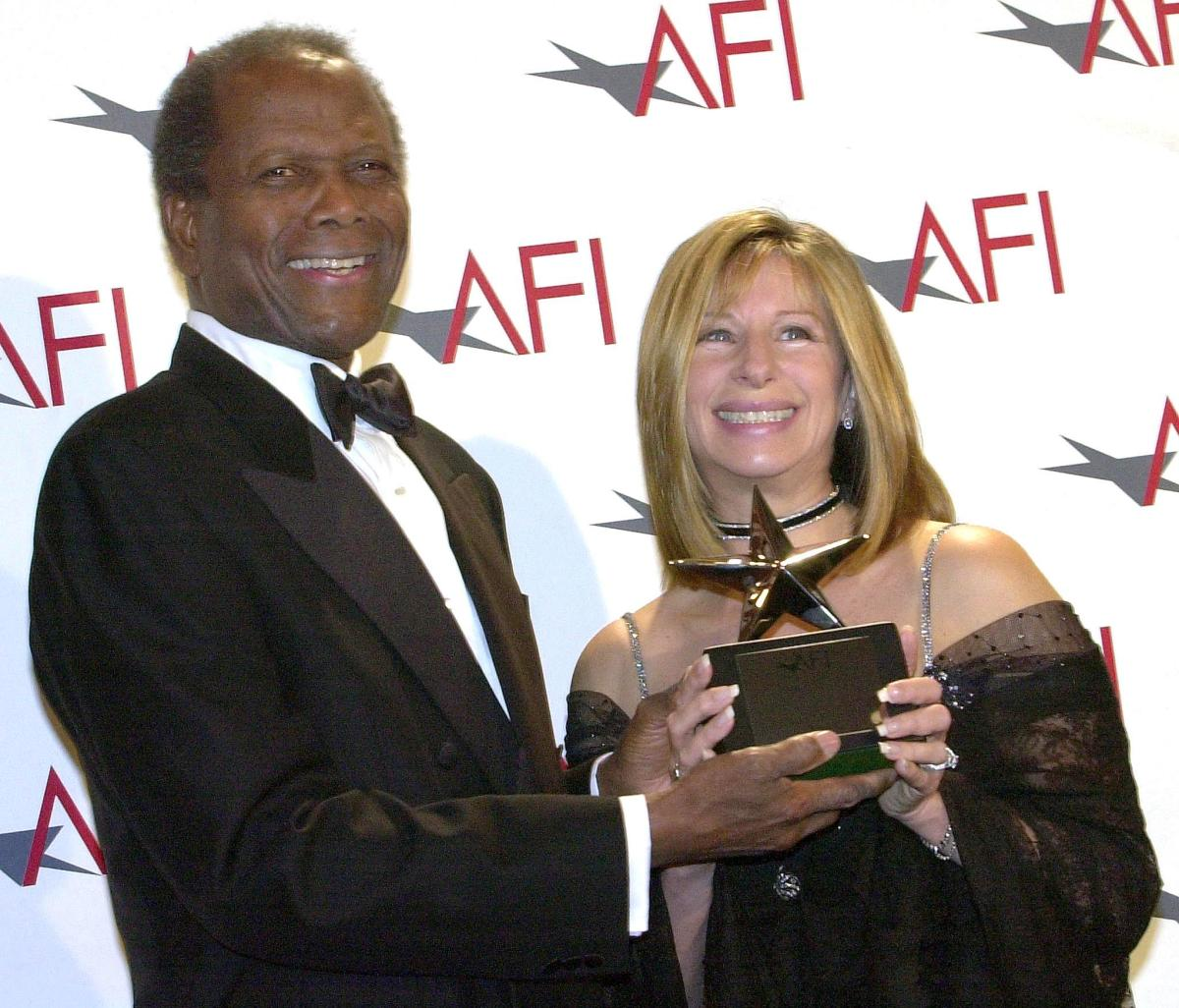 Barbra Streisand: In 2001 Sidney Poitier presents Streisand with the American Film Institute's Life Achievement Award in Beverly Hills, California.