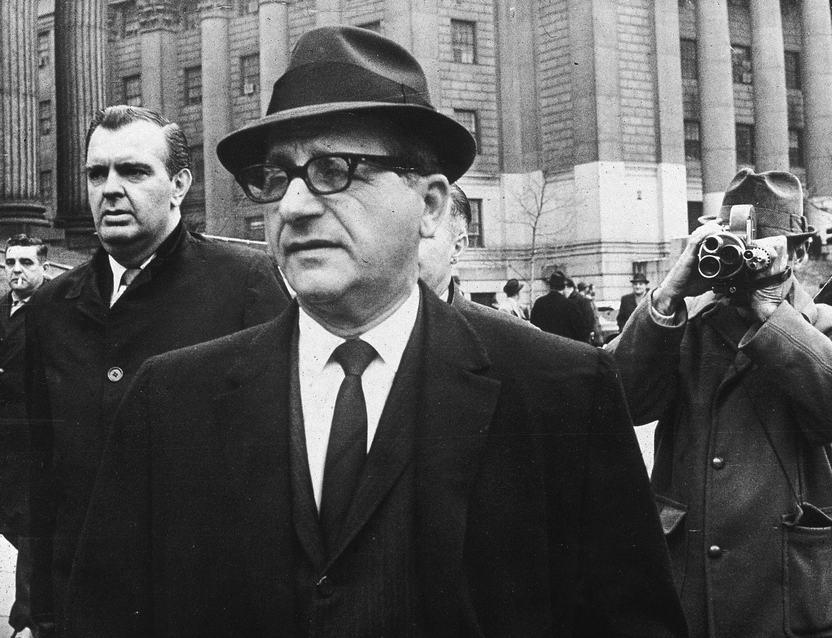 Infamous Mobsters: Chicago crime boss Sam Giancana leaves court after appearing before a federal grand jury in New York City in 1965. Giancana was under the protection of an FBI police detail when he was shot and killed in his Illinois home ten years later.