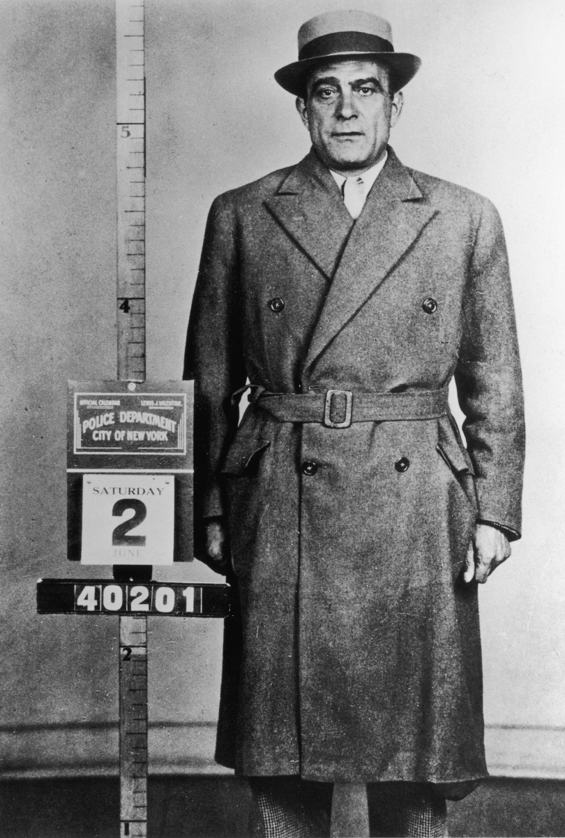 "Infamous Mobsters: Mob boss Vito ""Don Vito"" Genovese after his arrest in New York City in 1955. Don Vito went to prison in 1959 for conspiring to import and sell narcotics, specifically heroin."