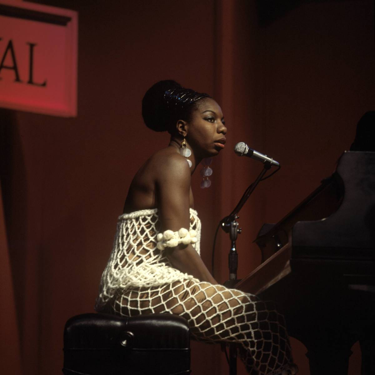 African-American Expats : Classical pianist and singer Nina Simone revolutionized American  jazz.  In search of a more racially equitable music scene and culture -  and to  avoid unpaid taxes - Simone traveled to Liberia, Switzerland,  and  Barbados before settling in the South of France in 1992. She lived  in  Aix-en-Provence until her death in 2003. (Photo: Redferns)
