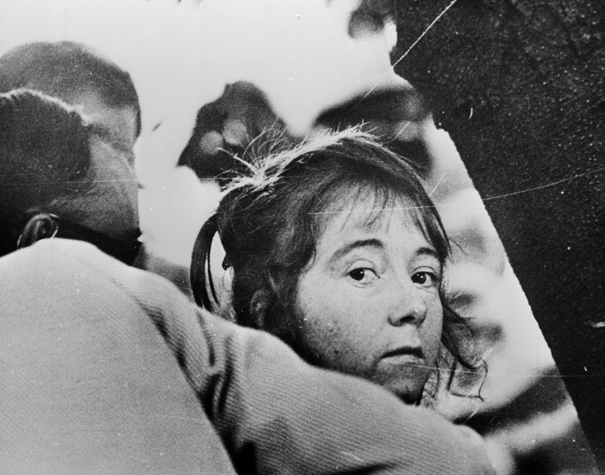 11th September 1975:  Lynette Fromme, a.k.a. Squeaky, an acolyte of Charles Manson, being led away after her failed attempt to kill President Ford.