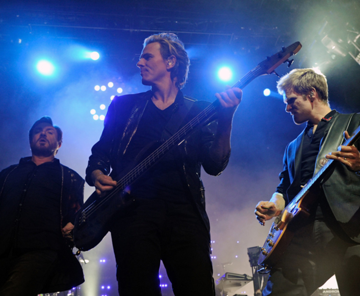 John (center) with Simon Le Bon (left) and guitarist Dom Brown (right) at The Hard Rock Hotel & Casino in 2011