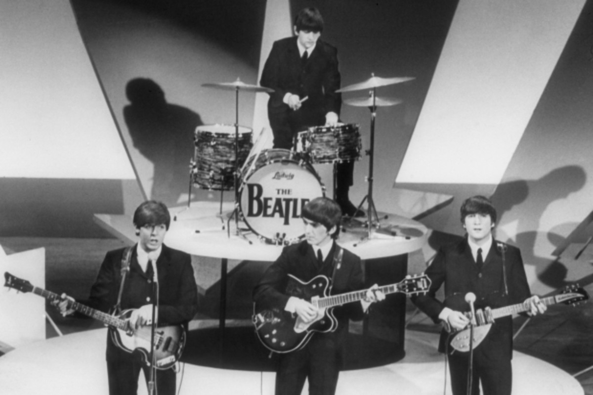 (L-R) Bassist Paul McCartney, guitarists George Harrison and John Lennon and Drummer Ringo Starr (at back) of the rock and roll band 'The Beatles' perform during rehearsals for their appearance on 'The Ed Sullivan Show' on February 9, 1964 in New York City, New York. (Photo by Michael Ochs Archives/Getty Images)