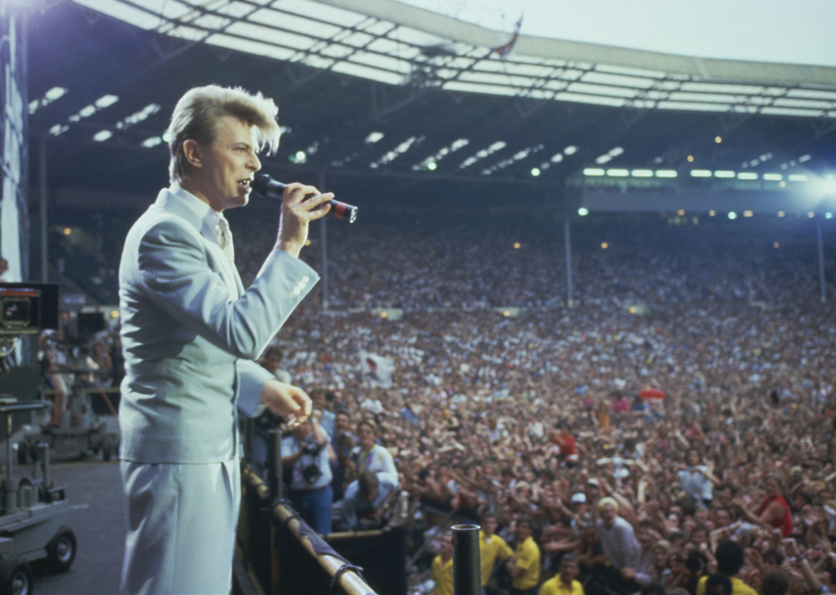 David Bowie: Bowie onstage at Bob Geldorf's Live Aid concert, which raised funds for Ethiopian famine relief, at Wembley Stadium in London, 1985. (Photo by Georges De Keerle/Getty Images)