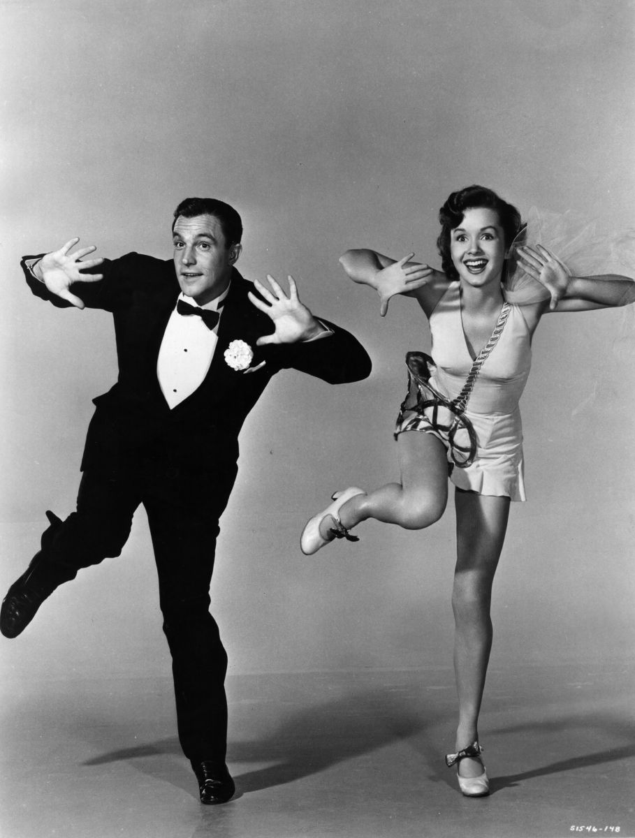 Gene Kelly: Debbie Reynolds was 18 when she starred as Gene Kelly's love interest in Singin' in the Rain. She had never sung or danced before, but she said learned a lot from Kelly whom she has described 'as the most exacting director I ever worked for.' (Photo by Hulton Archive/Getty Images)