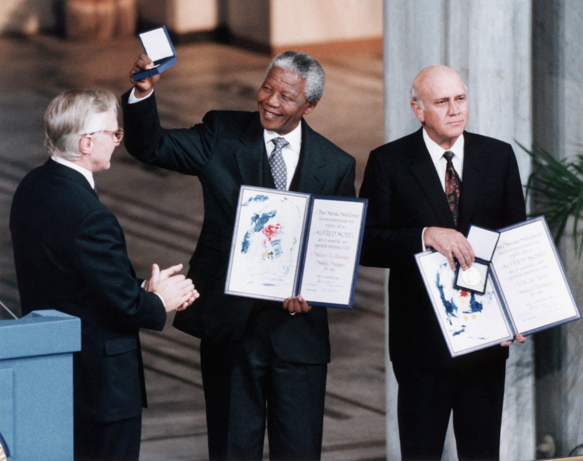 African National Congress leader Nelson Mandela holds up his medal and certificate after he was jointly awarded the 1993 Nobel Peace Prize with South African President F.W. de Klerk.