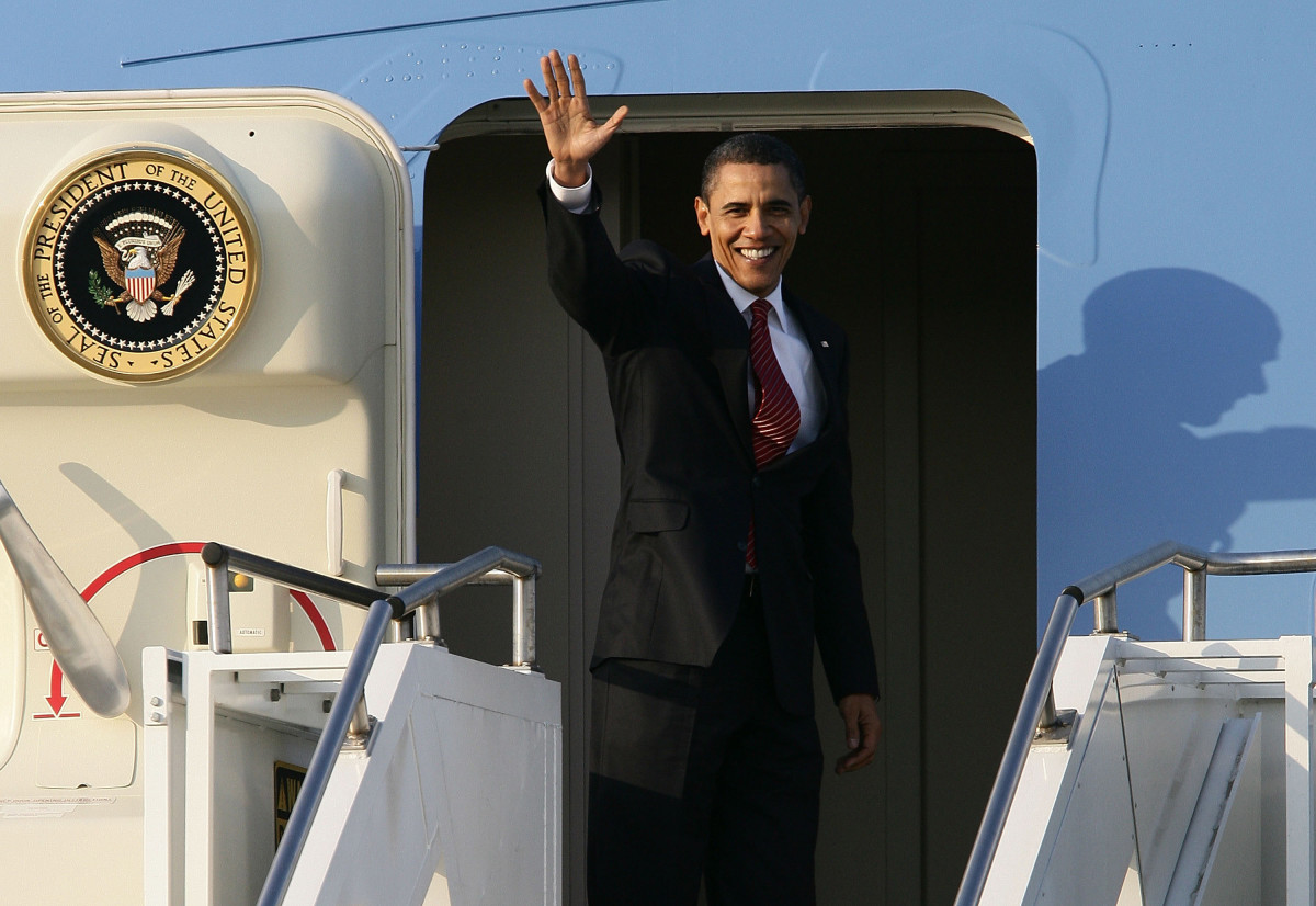 Barack Obama: President Obama waves to the crow as he leaves Osan, South Korea. Osan was the final destination on his first tour of Asia as President.