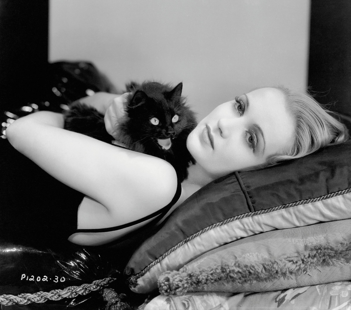 Carole Lombard, 1932. Seen here posing with a black cat in a studio publicity shot. (Photo: John Kobal Foundation)