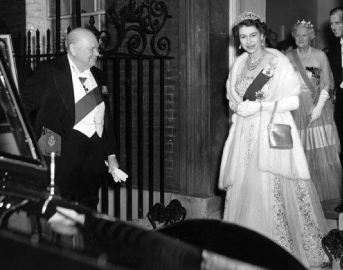 Winston Churchill was the first of 12 prime ministers who have met with Queen Elizabeth II since she took the throne in 1953. (Photo: Fox Photos/Getty Images)
