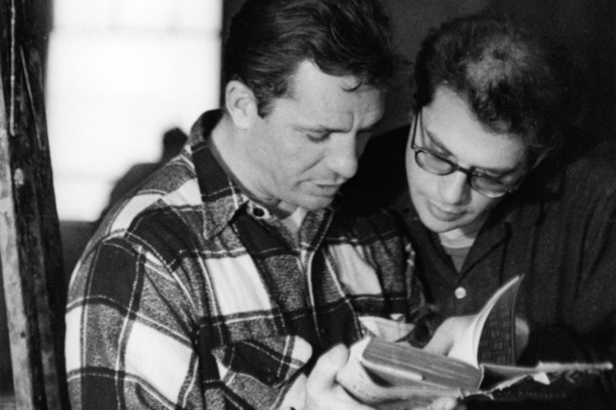 Kerouac reading a book with Ginsberg, 1959. (Getty)