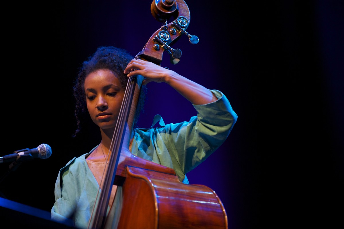 Esperanza Spaulding playing bass.
