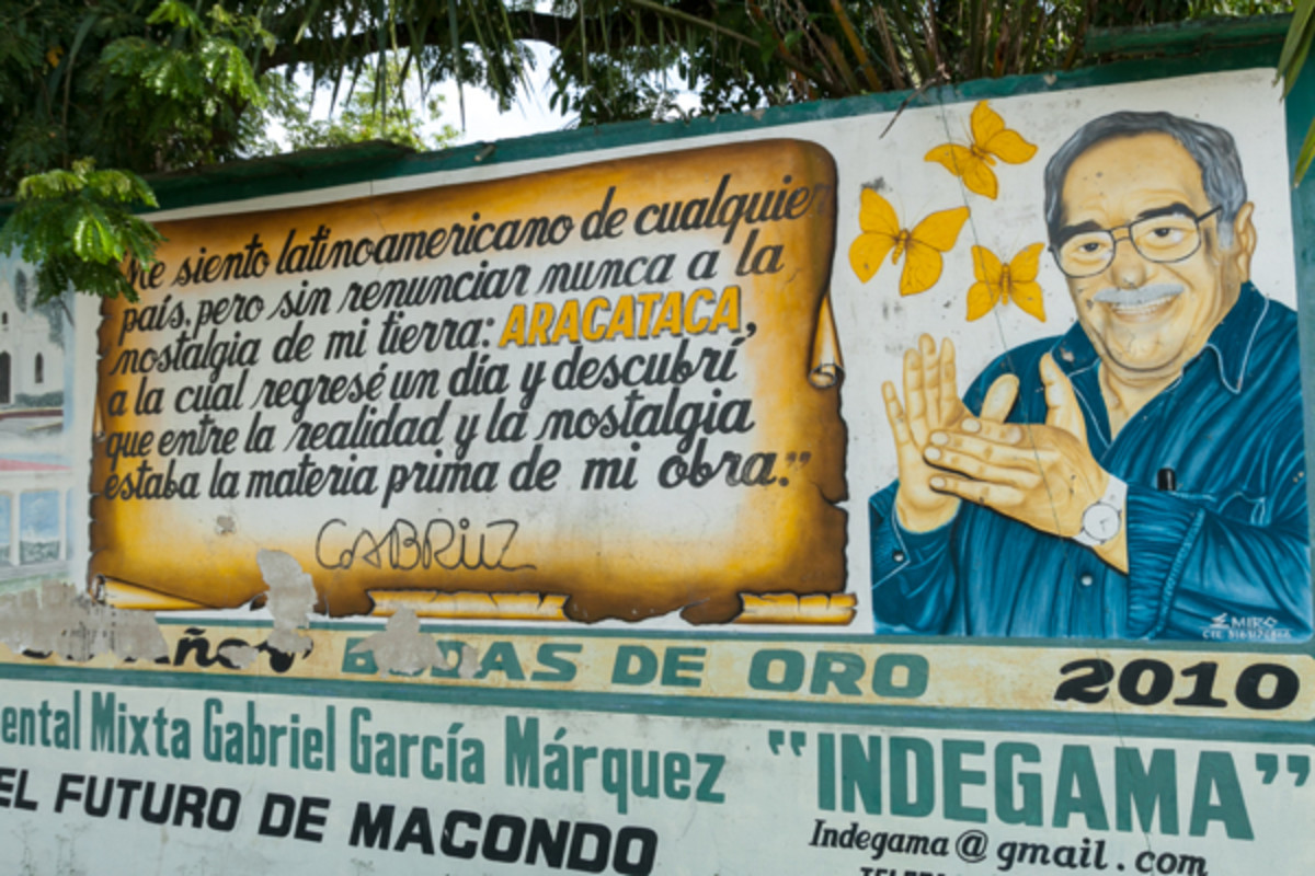 A mural on the outskirts of Aracataca contains a quote from Garcia Marquez, the town's most famous native son. (Photo: Eric Mohl)