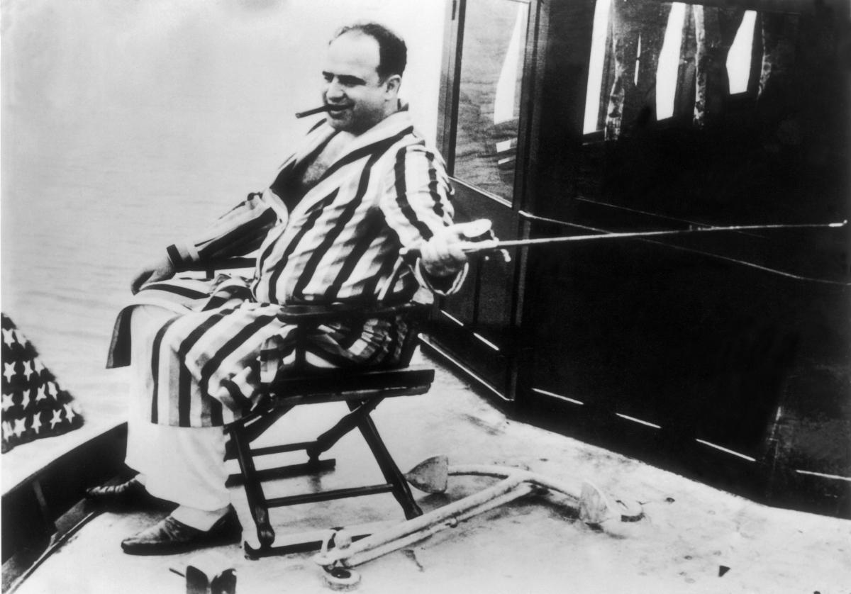 Infamous Mobsters: Chicago mobster Al Capone enjoys a moment of tranquility on his yacht in this photo taken between 1925 and the gangster's arrest in 1930.